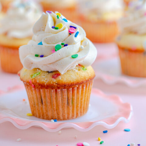Yellow cupcake with russian buttercream and sprinkles