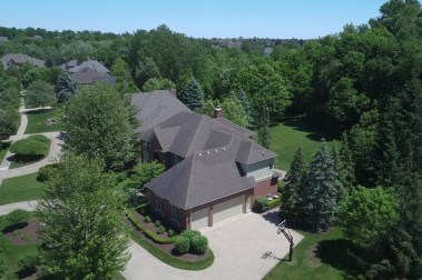 Aerial Image of Rear Yard and Woods