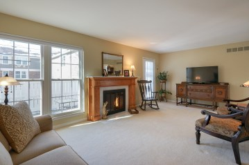 Gas Fireplace with Custom Mantel and white brick surround & hearth