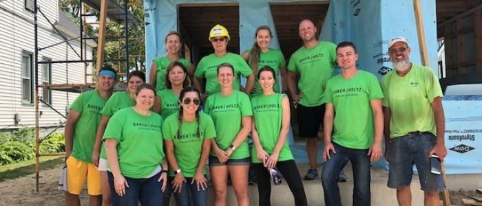Staff volunteering for Habitat for Humanity