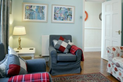 Living room with sofa and two arm chairs