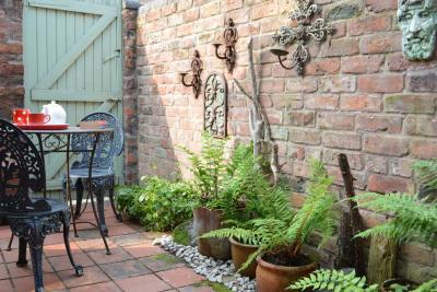 The dining room opens onto a small private yard
