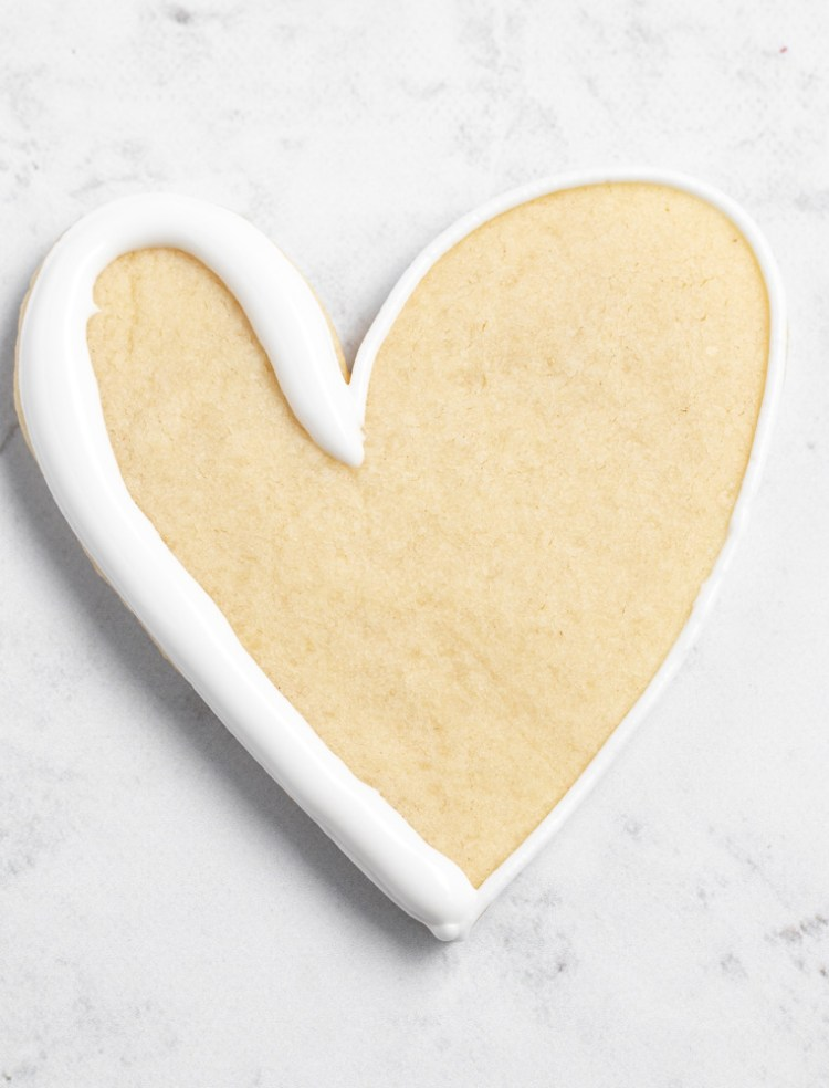 Royal Icing Outline on cookie with some flood icing