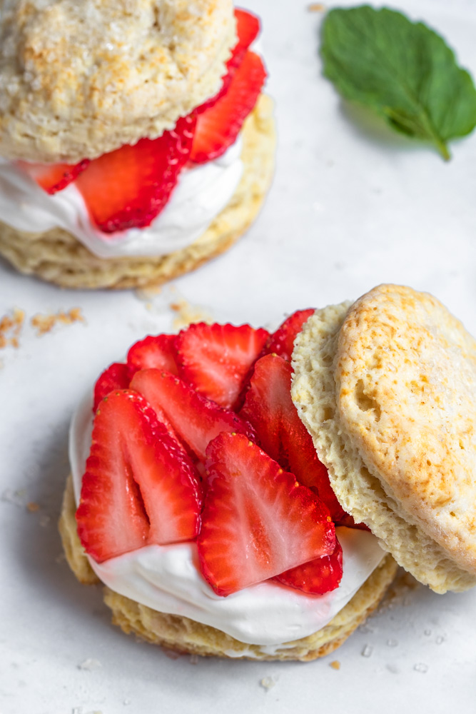 Strawberry Shortcake cut in half with cream and berries
