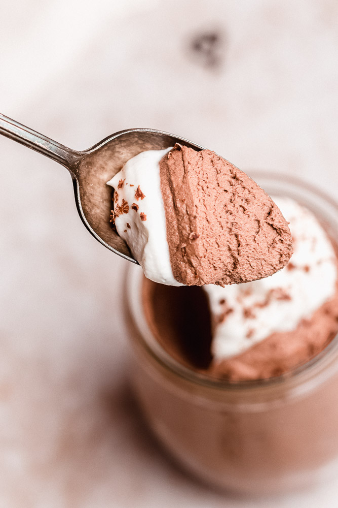 close up of chocolate mousse on a spoon
