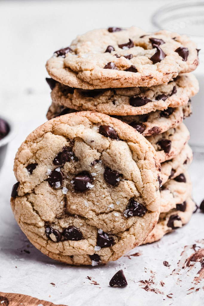stack of chocolate chip cookies with one in front