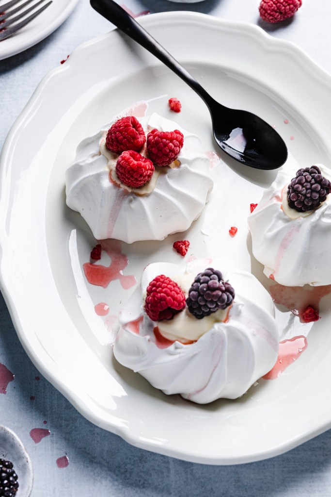 mini pavlovas with lemon curd and berries