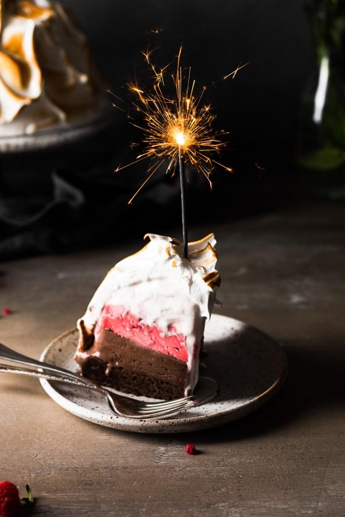 Slice of brownie baked alaska with chocolate and raspberry ice cream