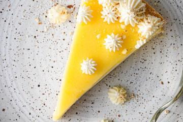 lemon curd mascarpone tart slice on a plate