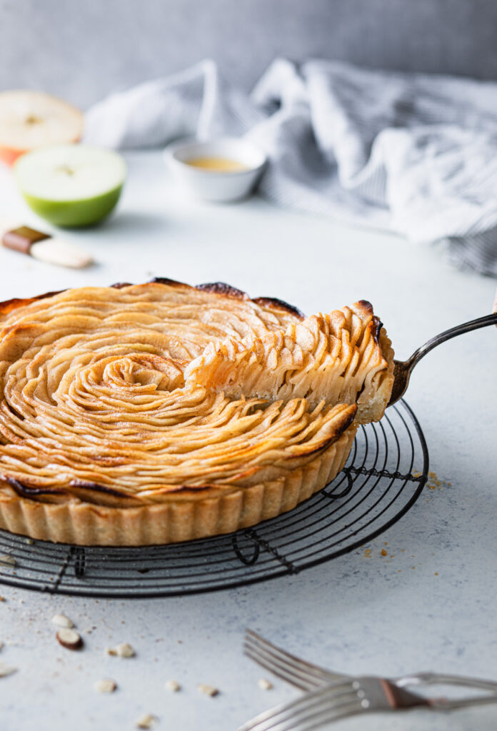 pulling a slice of apple tart out of the apple tart