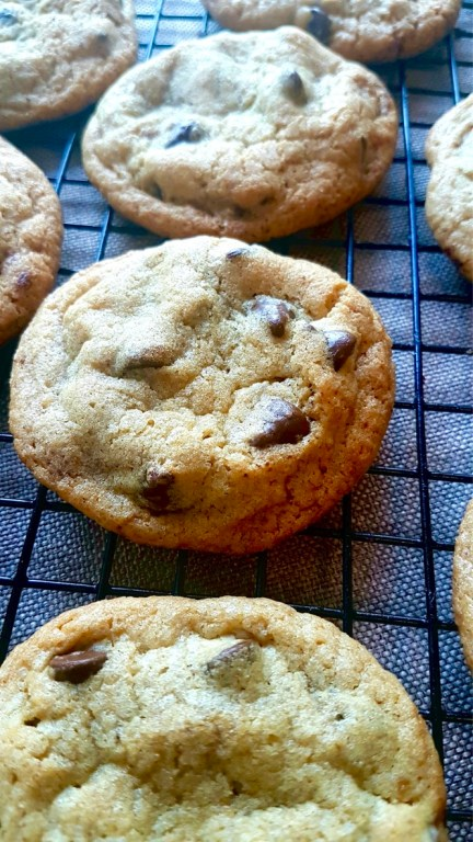 soft and chewy chocochip cookie on a wire rack