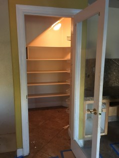 Pantry door, existing shelves as you walk straight in.