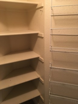 """Shelves to the right and the opposite side of the angled wall where we added our own """"canned goods"""" storage."""