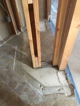 New pantry space where tile is missing.