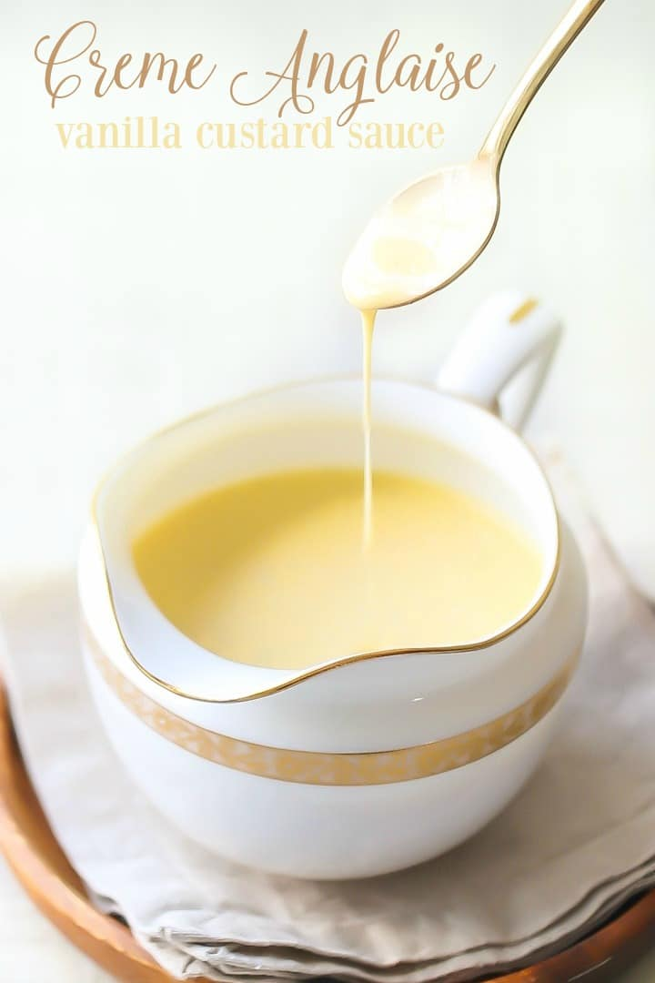 Creme Anglaise: sweet vanilla custard sauce being drizzled from a gold spoon into a small decorative pitcher.