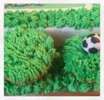 Zitronen-Muffins mit Gras aus Buttercreme