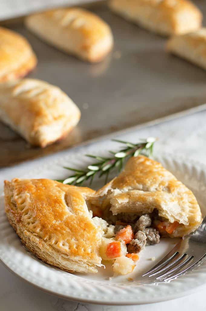 Image of beef pasties made with leftover buttermilk on a white plate.