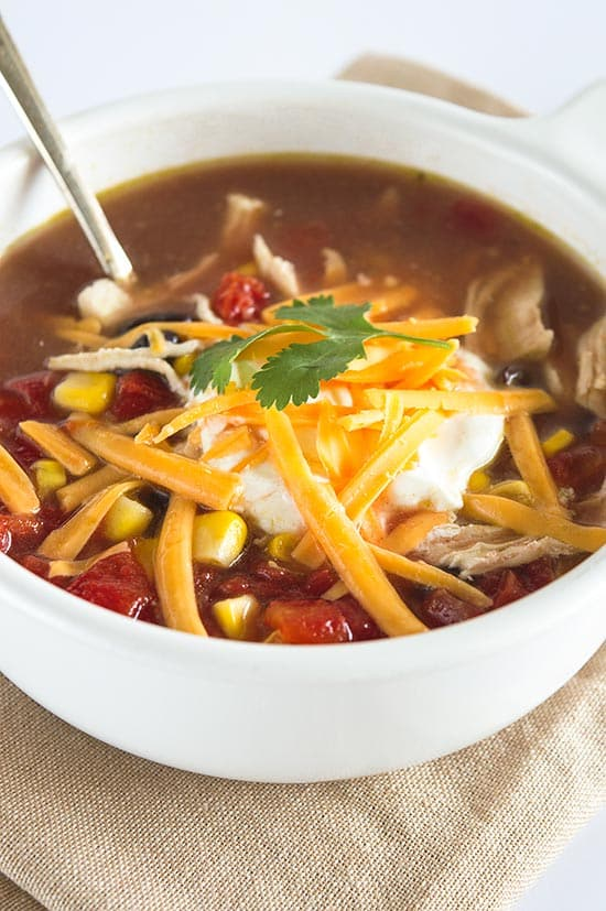 World's Easiest Chicken Taco Soup - A healthy and delicious chicken soup for quick weeknight dinners. So good, you'd never guess it takes fewer than 10 minutes to make. From BakingMischief.com