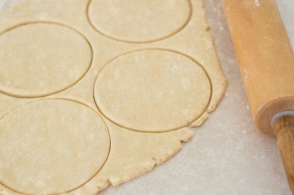 Buttermilk pie dough being cut into rounds.