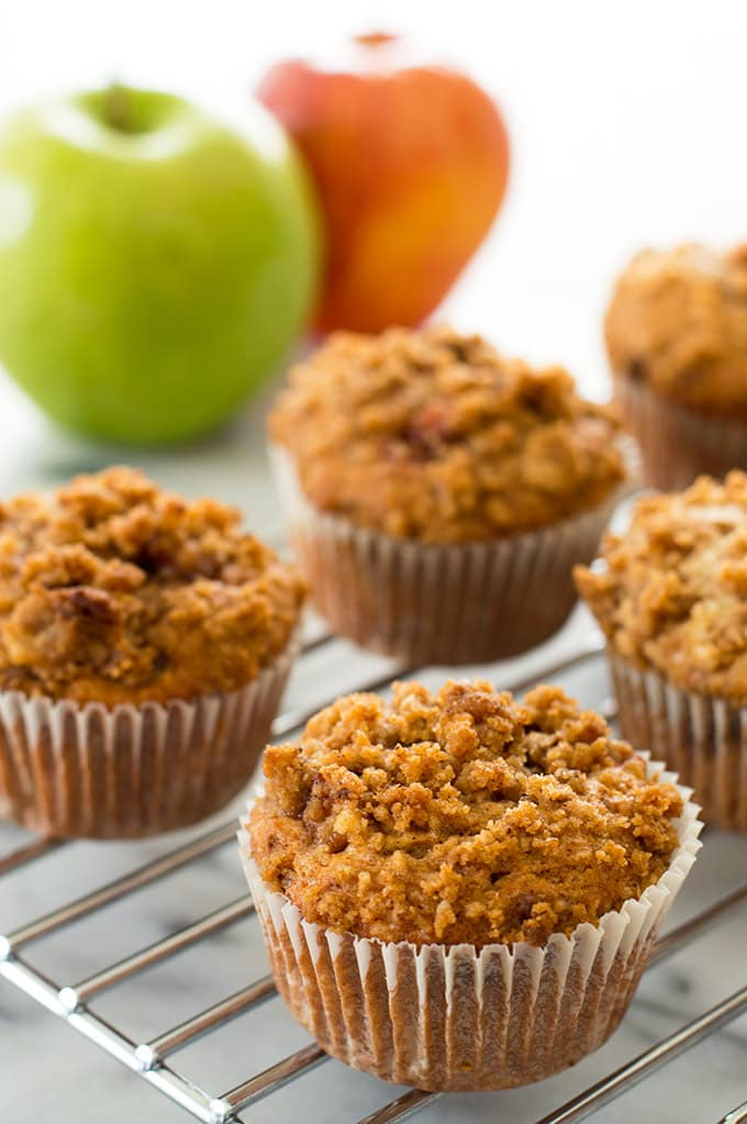 Apple crumb muffins on a cooling rack.