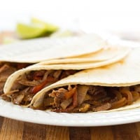 Easy slow cooker beef fajitas are a fantastic, cheap, and simple dinner for busy weeknights!