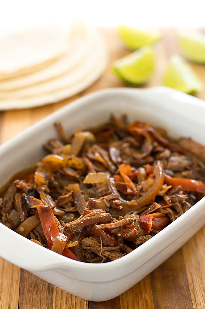 Slow cooker beef fajita mix in a white dish.
