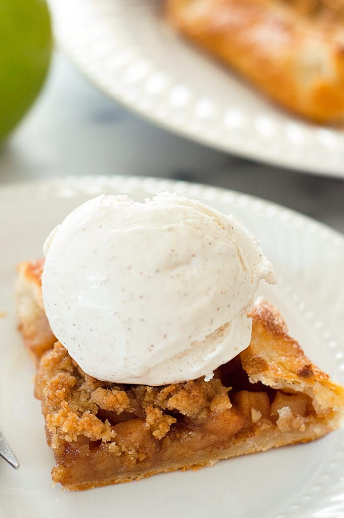 Slice of Dutch Apple Galette with a scoop of ice cream.