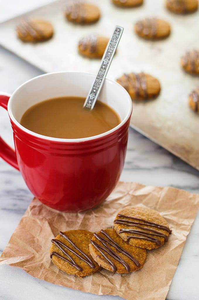 Pumpkin shortbread cookies with a cup of coffee.