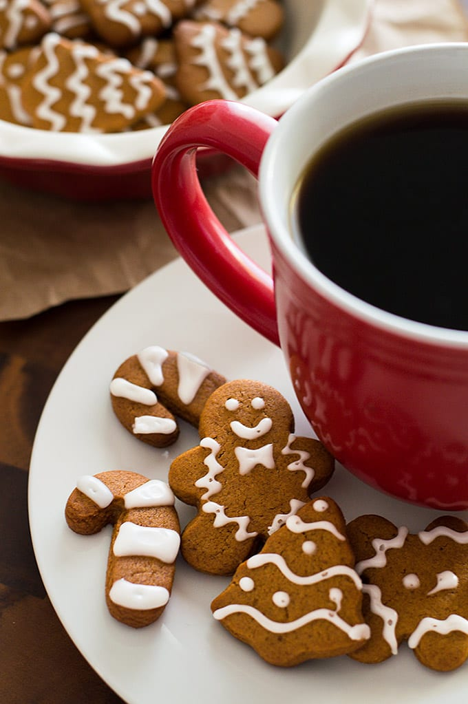 Small batch of gingerbread cookies on a plate with coffee.