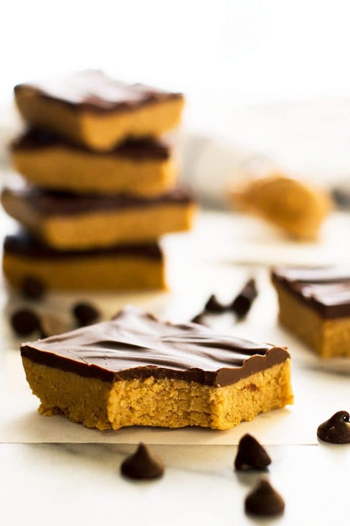 Picture of a peanut butter bar with a bite out of it.