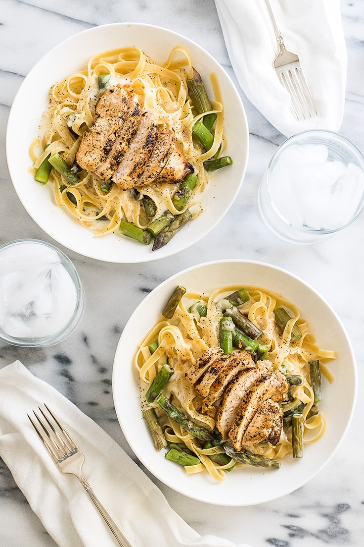 This easy Creamy Chicken and Asparagus Pasta is quick and simple to make and perfect for nights when you need a cheesy pasta fix! | Recipe for Two | Dinner for Two | Easy Pasta |