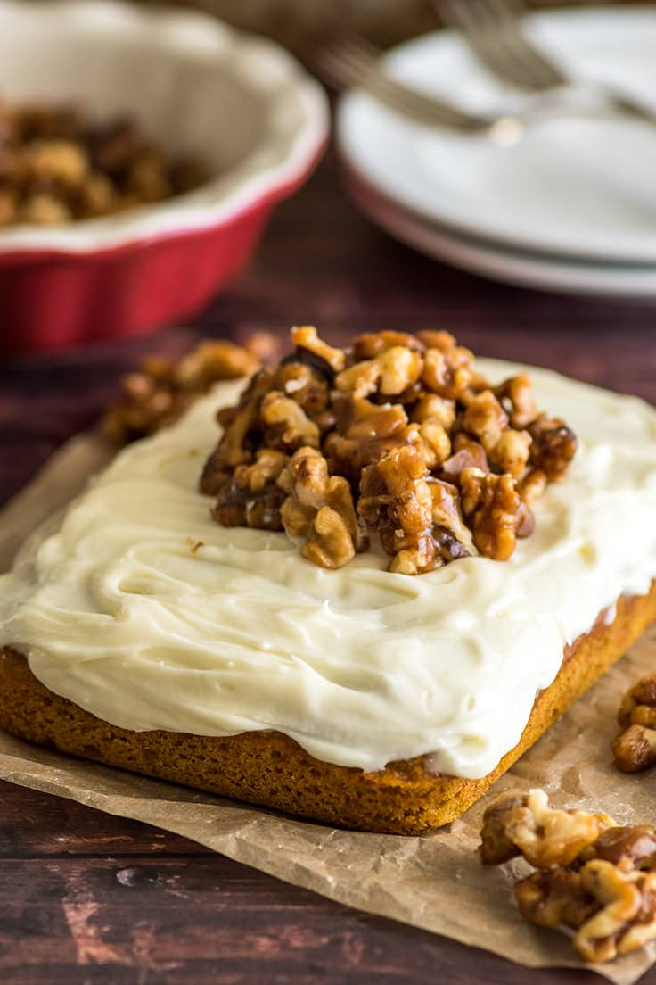 Mini Pumpkin Cake with cream cheese frosting and candied walnuts.