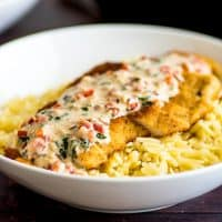 Easy Chicken in Cream Sauce for Two, crispy breaded chicken served over orzo or rice with a two minute basil and Parmesan cream sauce. | #Chicken | #ChickenDinner | #DinnerForTwo |