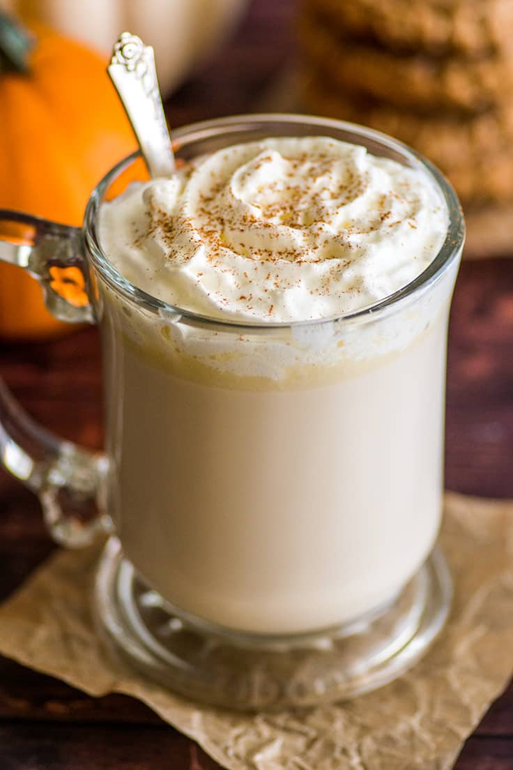 A glass of Chai White Hot Chocolate with whipped cream.