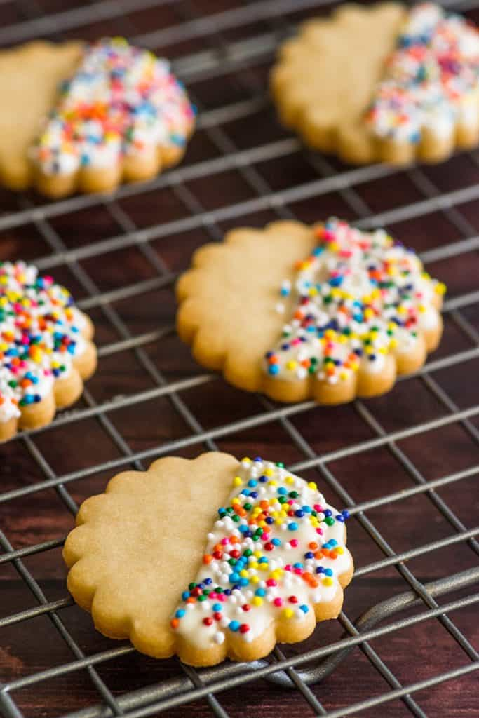 Small-batch shortbread cookies with sprinkles on a baking rack.