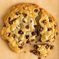 Square photo of One Chocolate Chip Cookie for Two broken into pieces.