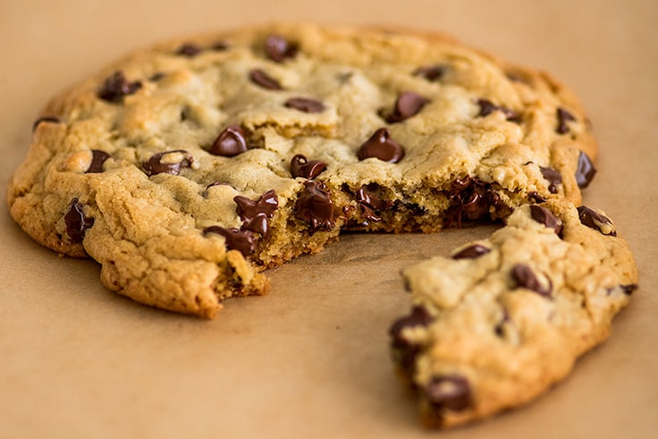 Photo of One Chocolate Chip Cookie for Two split into two pieces.