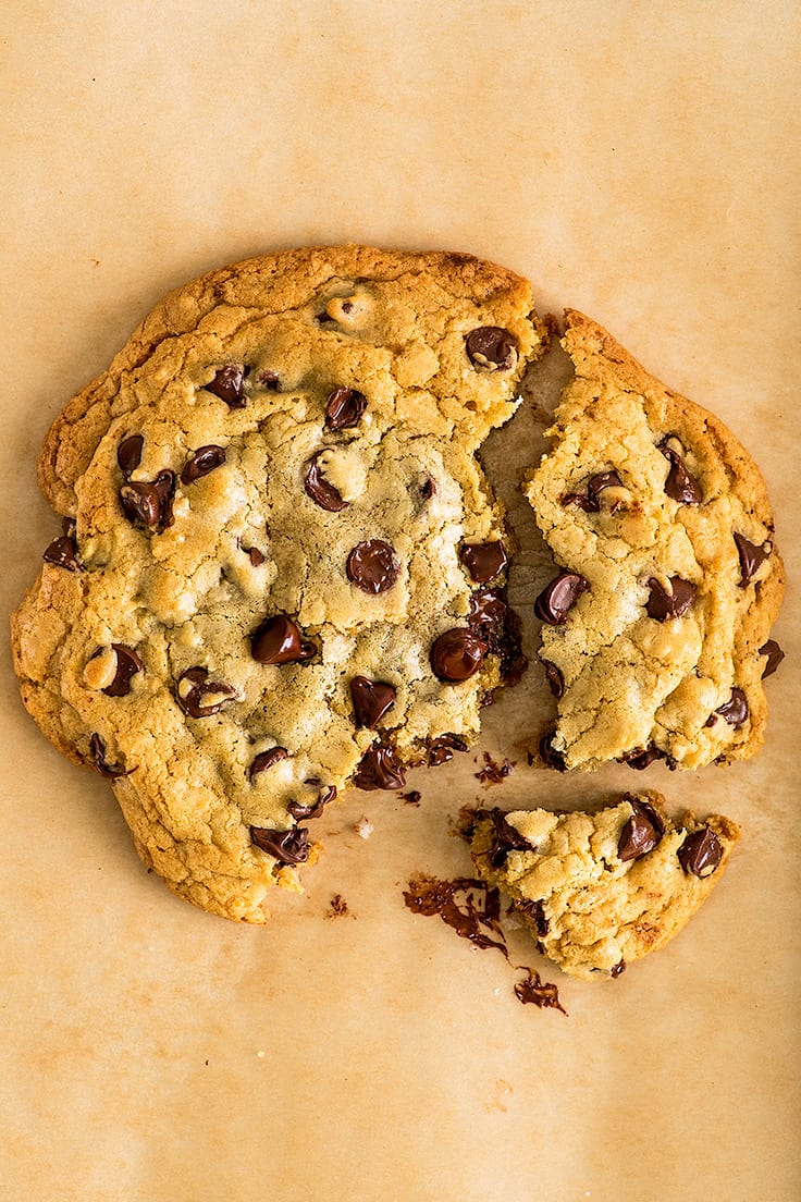 Photo of One Chocolate Chip Cookie for Two broken into pieces.