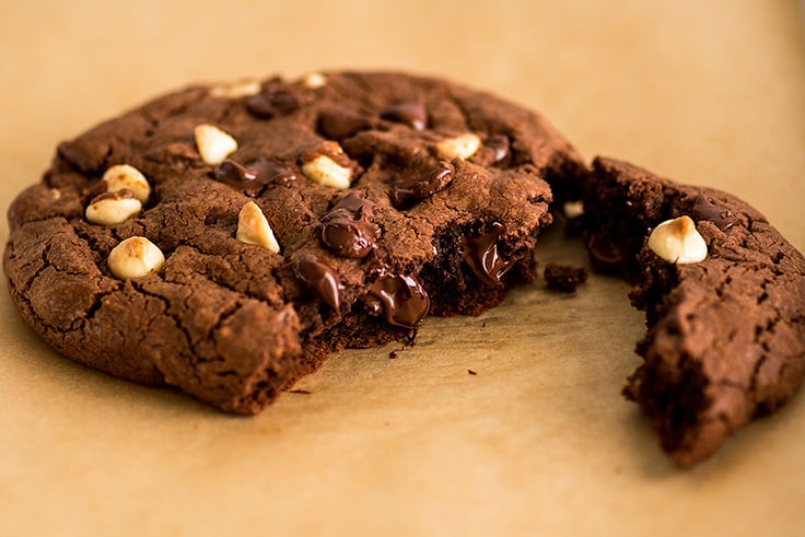 Photo of One Triple Chocolate Cookie for Two broken into two pieces.
