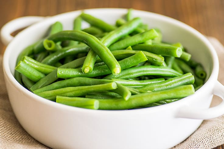 Image of How to Steam Green Beans in the Microwave step 4, cooked green beans in a bowl.