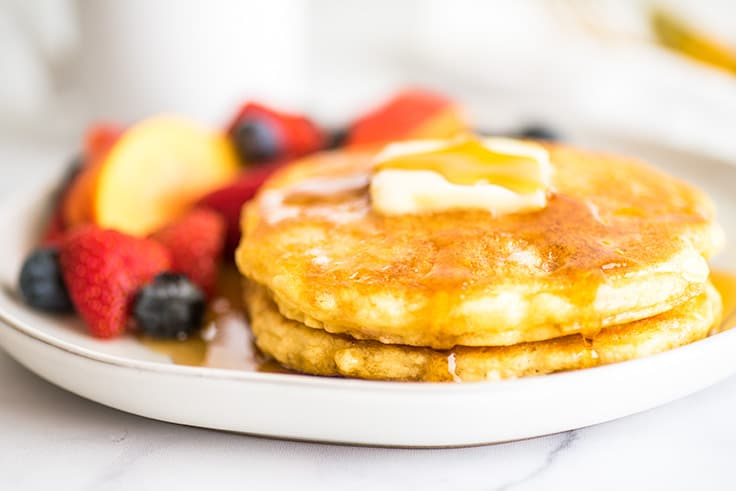 Picture of Quick and Easy Pancakes for One on a white plate with fruit.