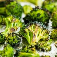 Crispy oven-roasted broccoli on a baking sheet.