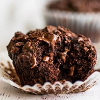 Small-batch Chocolate Banana Muffin with a bite out of it.