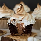 Gooey Chocolate S'mores Cupcake with a bite out of it.