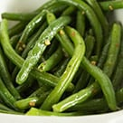 No Fail Butter and Garlic Green Beans in a white dish.