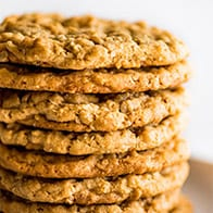 Easy Peanut Butter Oatmeal Cookies stacked on a plate.