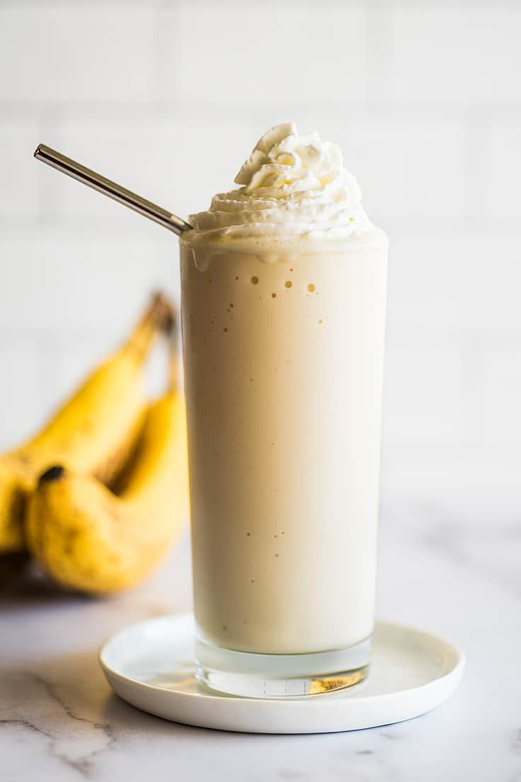 Banana milkshake in a tall glass.