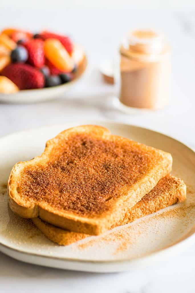 Photo of cinnamon sugar toast on a white plate.