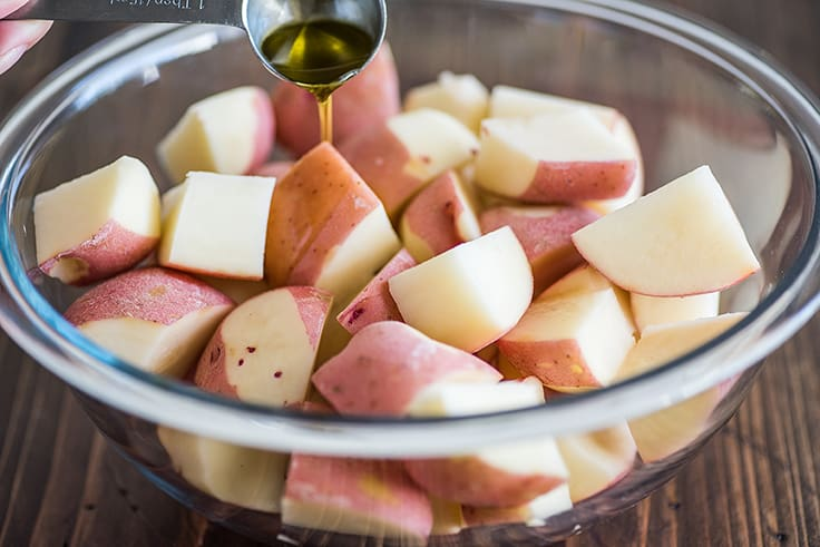 Cut red potatoes in a bowl.