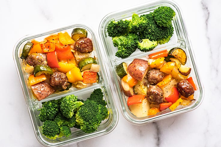 Meal prep containers with broccoli and sheet pan sausage and veggies.